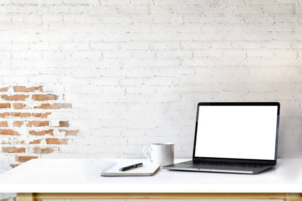Mockup laptop on white wood. stock photo