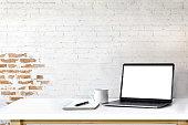 Mockup laptop on white wood.