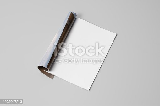 Mock-up magazine, newspaper or catalog on gray background. Blank page or notepad on paper backdrop. Blank page for mockups or simulations.