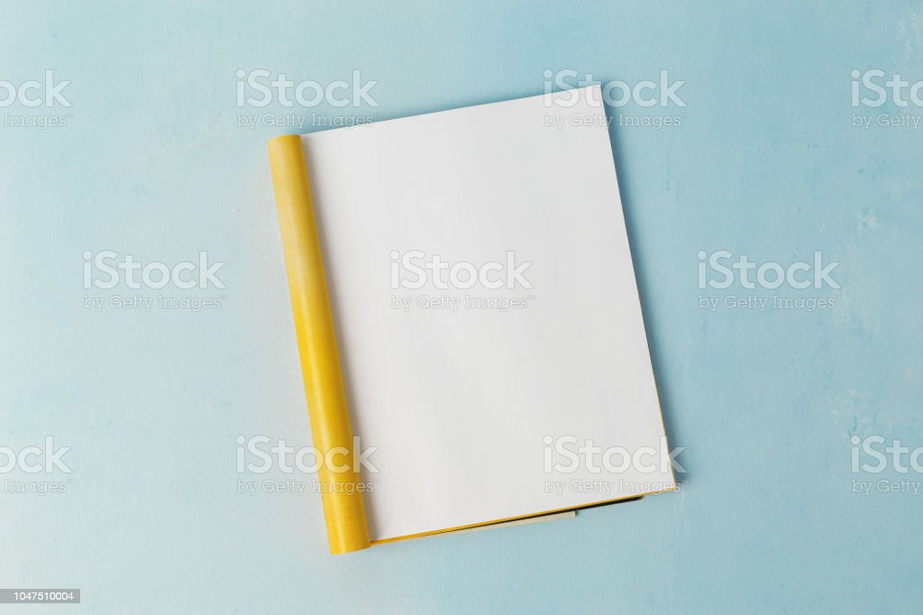 Mock-up magazine template. Open page of magazine on blue background....