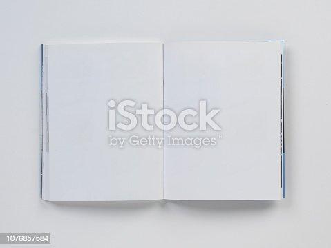 Mock-up magazines, book or catalog on white ta background.