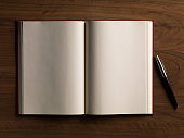 istock Mock-up magazines, book or catalog on white background. 1136593304
