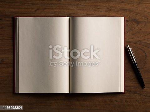 Mock-up magazines, book or catalog on white table background.