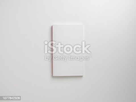 Mock-up magazines, book or catalog on wooden table background.