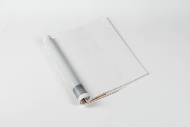 Magazines de maquette ou catalogue sur fond de tableau blanc. - Photo