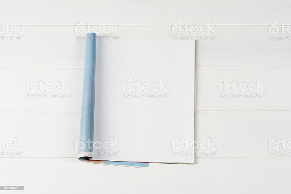 Mock-up magazines or catalog on wooden table background. stock photo