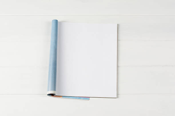 Mock-up magazines or catalog on wooden table background. Mock-up magazine or catalog on wooden table. Blank page or notepad on wood background. Blank page or notepad for mockups or simulations. catalog stock pictures, royalty-free photos & images