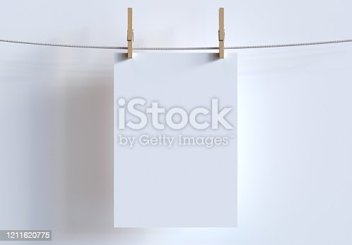istock Mockup Of A4 Sheet Hanging With Clothespins On Clothesline. 3d Render. 1211620775