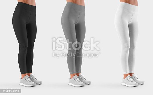 Mockup of black, white, gray leggings on a fit girl in sneakers, for presentation of design, front view. Template female pants isolated on background. Set of sportswear on a slim model