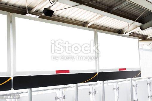 istock Mock-up of blank billboard for display product or artwork. Billboard on Train Station 962832732