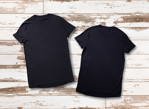 Mockup of blank black tshirt front and rear on white wooden background. Shirt design for man. Flat lay, top view.