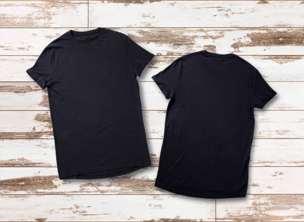 Mockup of blank black tshirt front and rear on white wooden background. Shirt design for man. Flat lay, top view. Mockup of blank black t shirt on white wooden background. Shirt design front and rear for man close up. Flat lay, top view. black shirt stock pictures, royalty-free photos & images