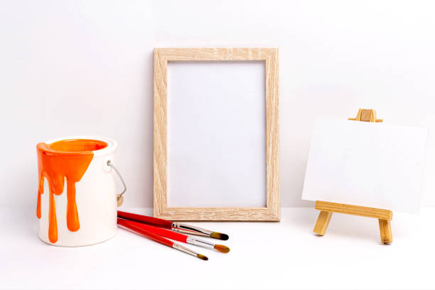 Mockup of blank photo frame and canvas on easel stock photo