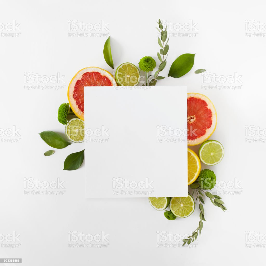 Mockup of card decorated by citrus fruits and leaves. stock photo