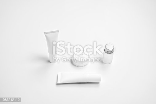 927626522 istock photo Mockup of cosmetic cream bottle, Blank label package and ingredients on a white background. Concept of natural beauty products. 935212112