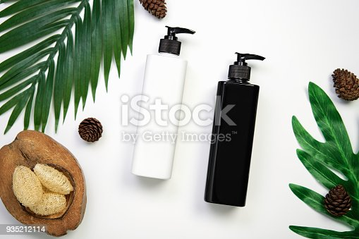 istock Mockup of cosmetic cream bottle, Blank label package and ingredients on a white background. Concept of natural beauty products. 935212114