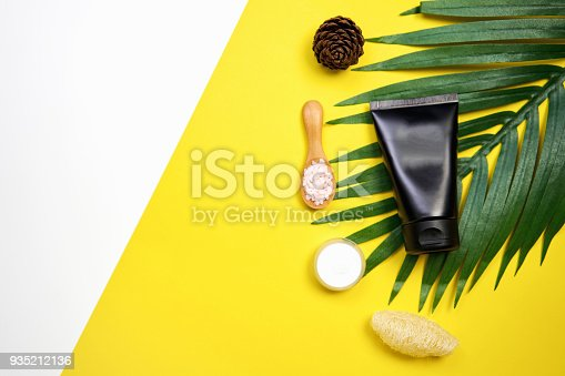 927626522 istock photo Mockup of cosmetic cream bottle, Blank label package and ingredients on a white and yellow background. Concept of natural beauty products. 935212136