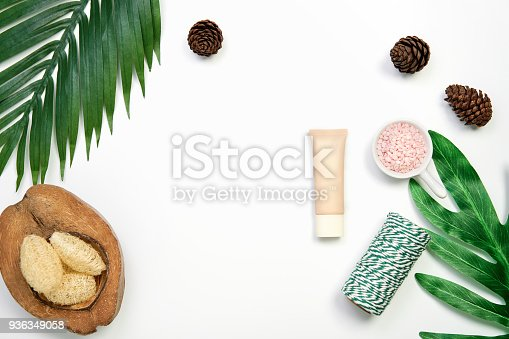 927626522 istock photo Mockup of cosmetic cream bottle, Blank label package and ingredients on a green leaves background. Concept of natural beauty products. 936349058