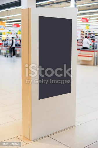 istock Mockup of digital white screen panel. Blank  modern media billboard in the shopping center. Place for text, advertising or public information. 1021256676