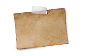 istock Mockup of empty old vintage yellowed paper sheet with scotch tape 1129071313
