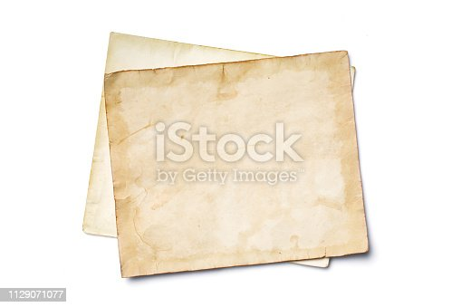 istock Mockup of empty old vintage yellowed paper sheets 1129071077
