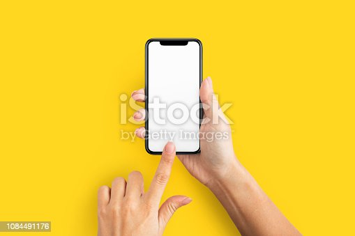 istock Mockup of female hand holding cell phone with blank screen 1084491176
