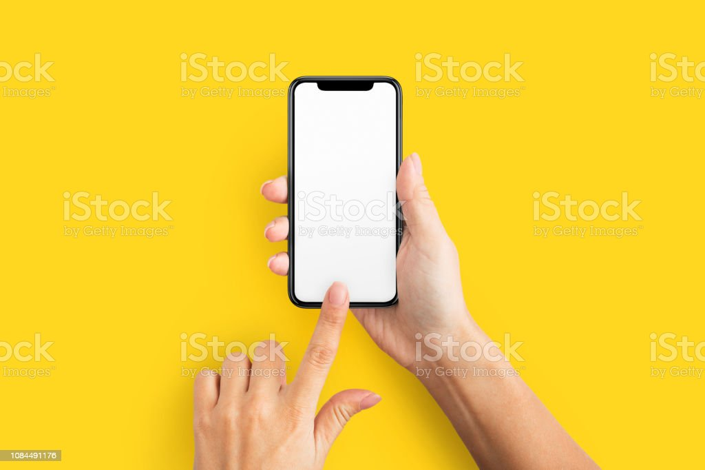 Mockup of female hand holding cell phone with blank screen stock photo