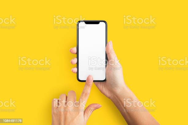 Photo of Mockup of female hand holding cell phone with blank screen