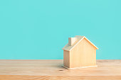 istock Mockup of house(home) made by wood with blue pastel color on wood table background.Property and estate or investment concepts 1151788032