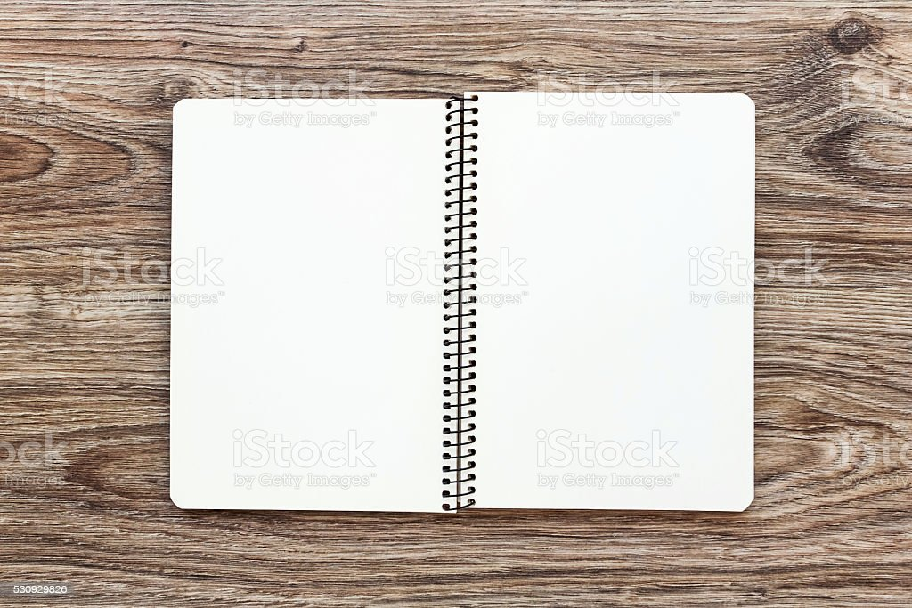Mockup of open notepad with blank pages on wooden background. stock photo