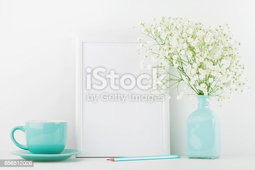 istock Mockup of picture frame decorated flowers in vase and coffee cup. Website design concept. 656512026