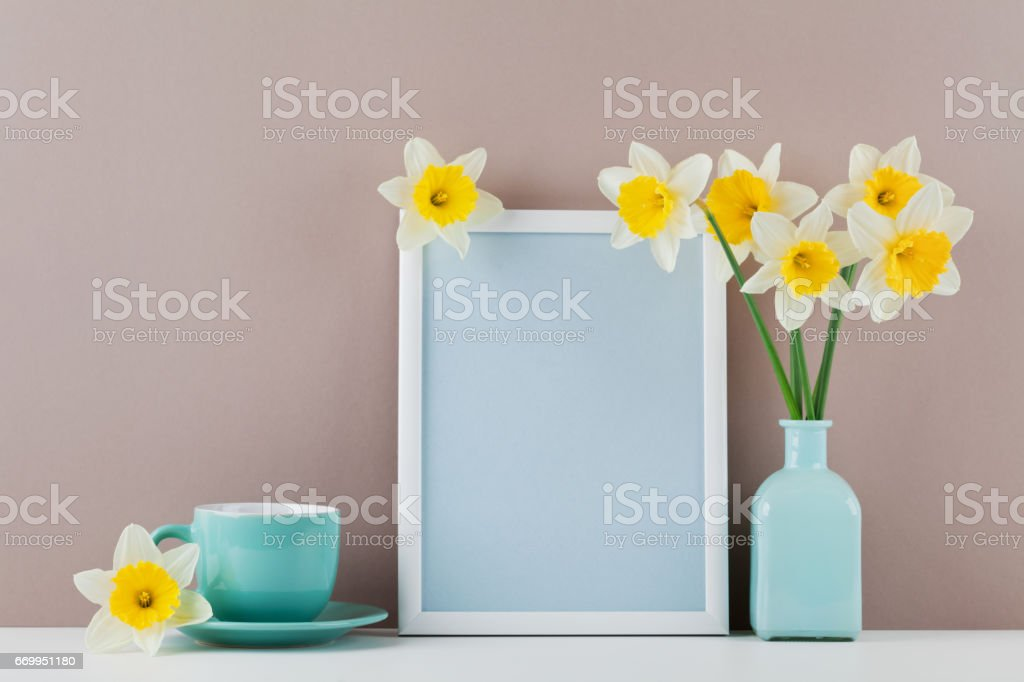 Mockup Of Picture Frame Decorated Narcissus Flowers In Vase And
