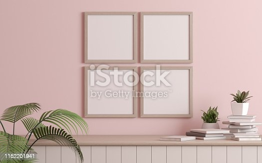 istock Mock-up of picture frame with small plant in vase and books on light pink wall. Perspective of modern Interior design. 3d rendering. 1152201941