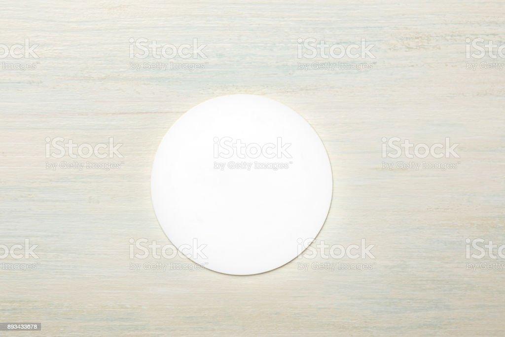 Mockup of round white business card on light background stock photo