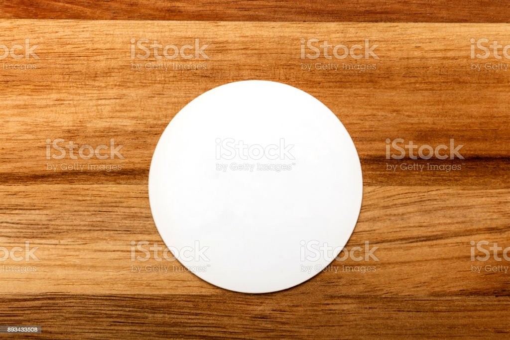 Mockup of round white business card on rustic background stock photo