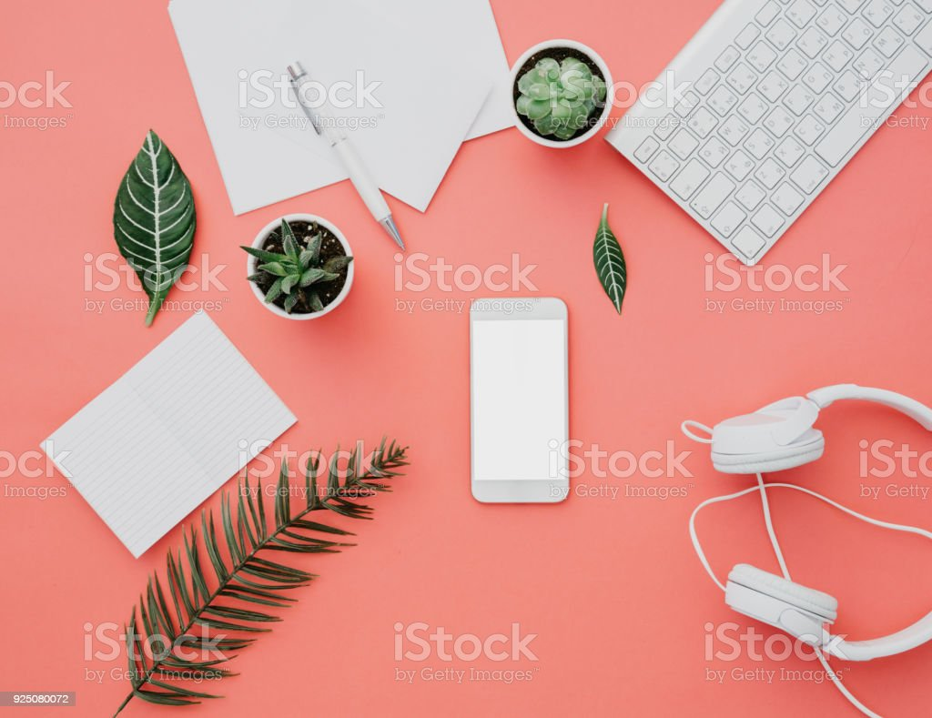 Mockup of smartphone with white screen on pastel background. Flat lay, top view workspace