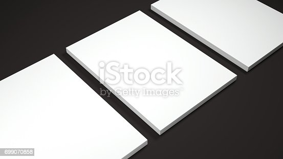 istock Mockup of three White A4 paper sheets on black background. Soft shadow. High resolution 3d render. 699070858