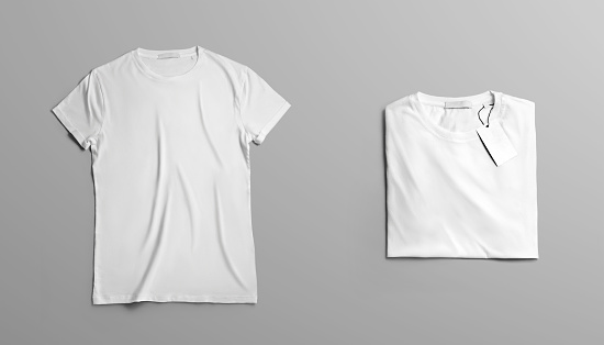 Mockup  clothes The first open blank T-shirt lies on grey studio background. Second  t-shirt  with label neatly folded on a background. Top view template for fashion design.