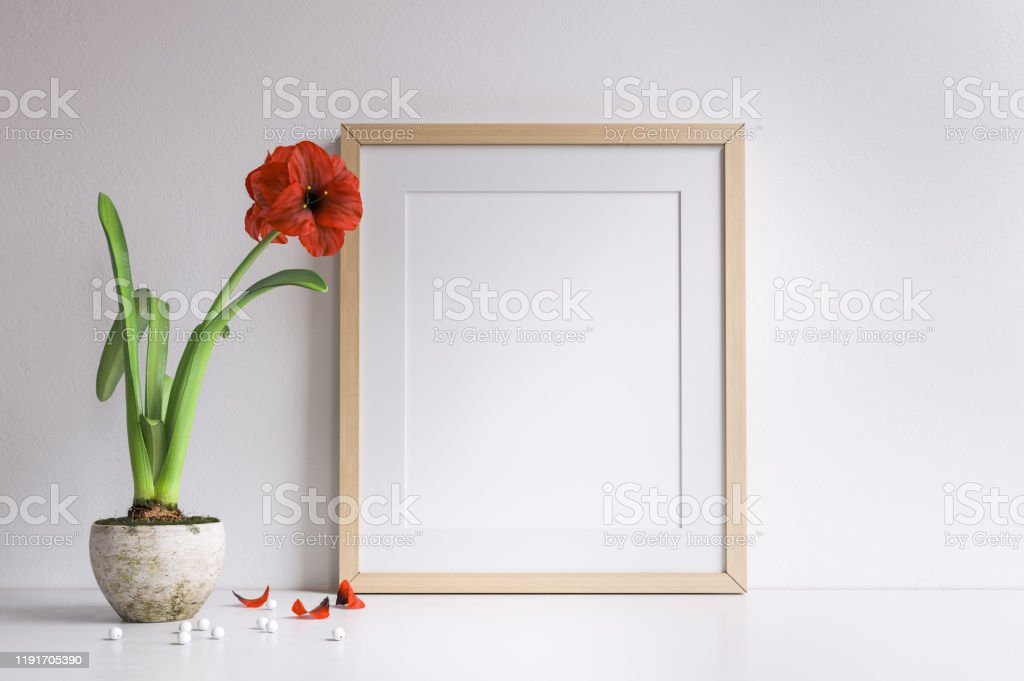 Mockup poster frame Mockup poster frame with corn rose flower Apartment Stock Photo
