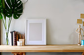 Mockup poster on wooden table with copy space.