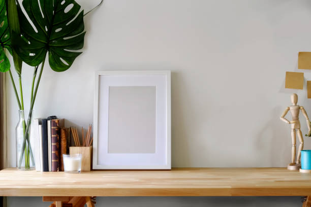 Mockup poster on wooden table with copy space. stock photo