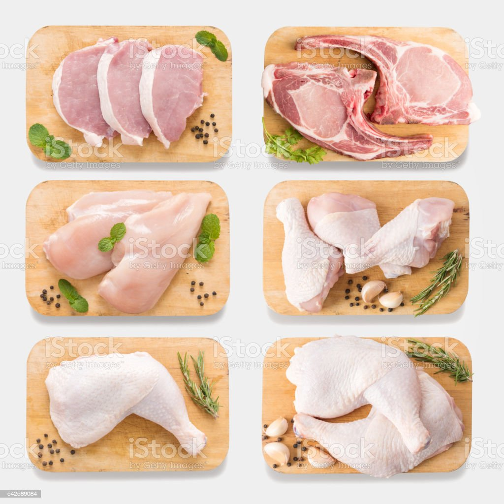 Mockup raw chicken and pork on cutting board set. isolated stock photo