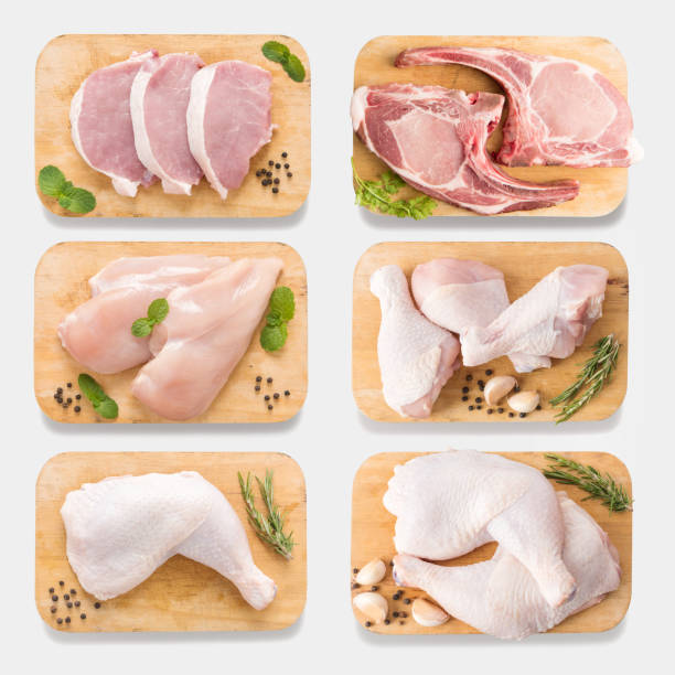 Mockup raw chicken and pork on cutting board set. isolated Mockup raw chicken and pork on cutting board set on  isolated on white background. Copy space for text and logo. Clipping Path included isolated on white background. white meat stock pictures, royalty-free photos & images