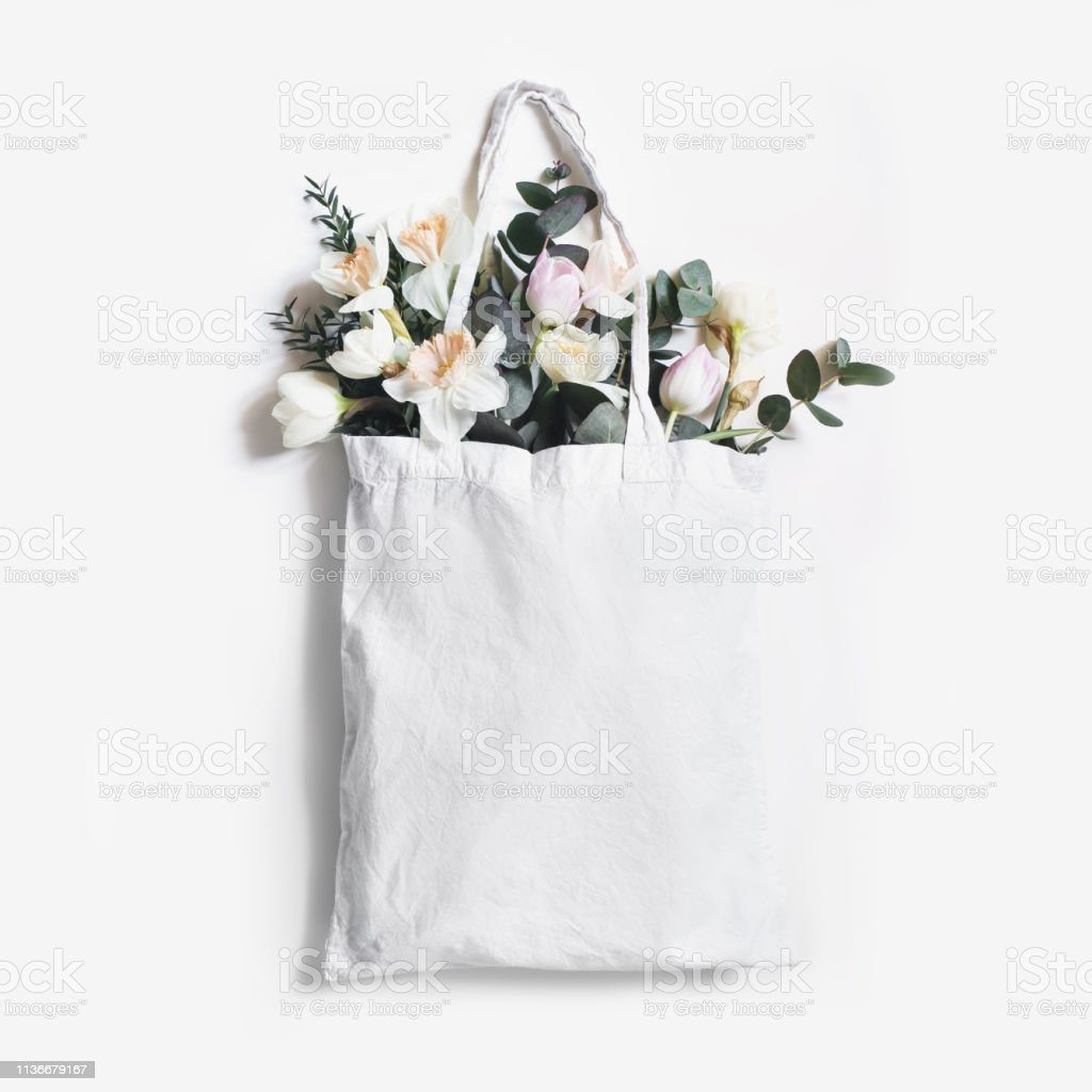 3b1d5ab5320f Mockup Scene Of Blank Shopping Canvas Tote Bag With Pink Tulips ...
