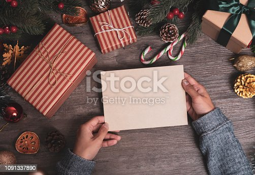 istock mockup tag paper card with christmas decoration on wood table background. 1091337890