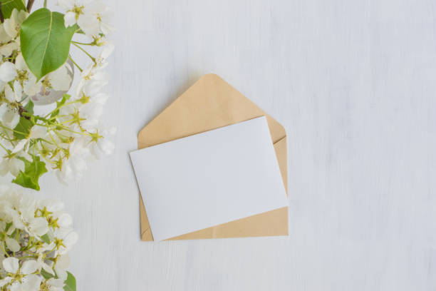 Mockup white greeting card with white spring flowers stock photo