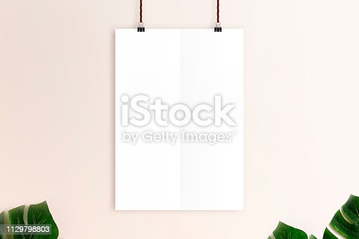532332971 istock photo Mockup white poster on rusty pink wall background. 1129798803
