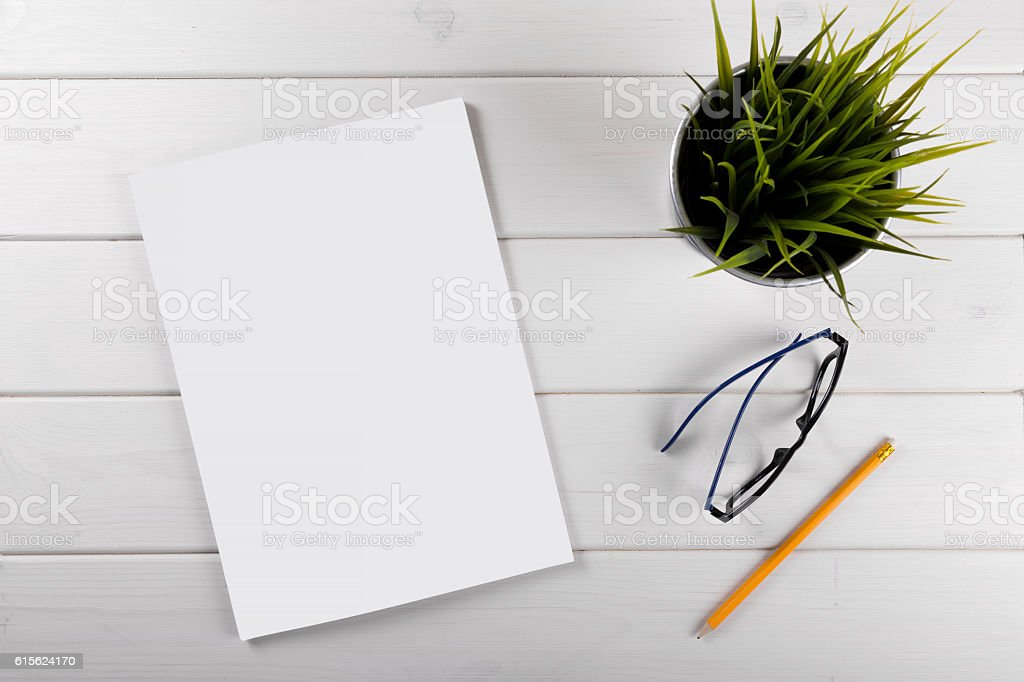 mockup with blank magazine cover on white wooden table stock photo