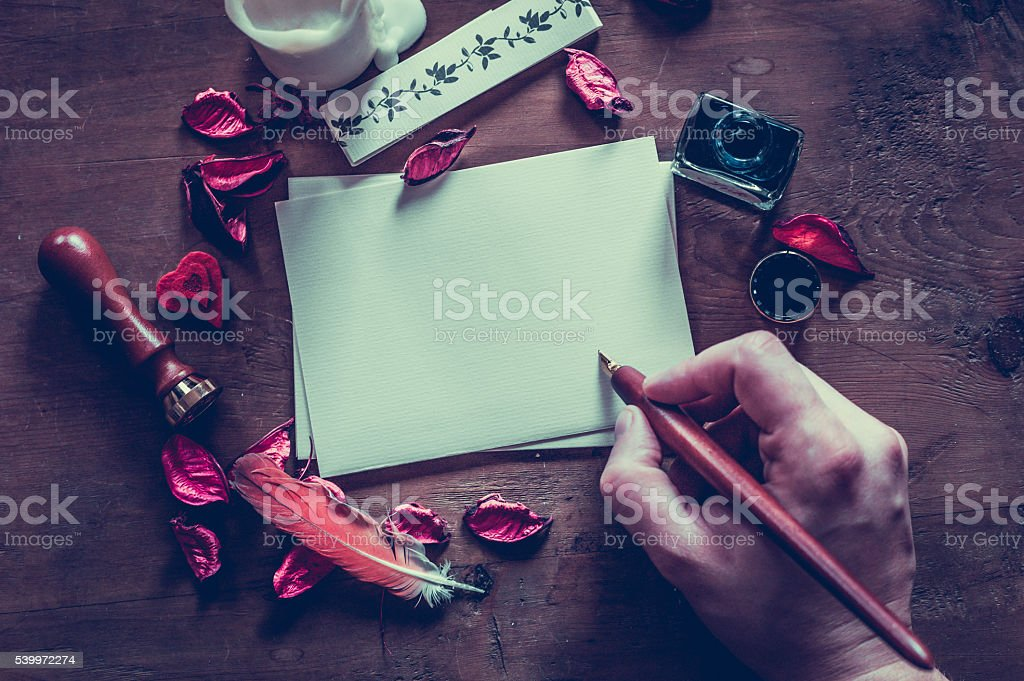 mock-up with hand of artist and calligraphic tools stock photo