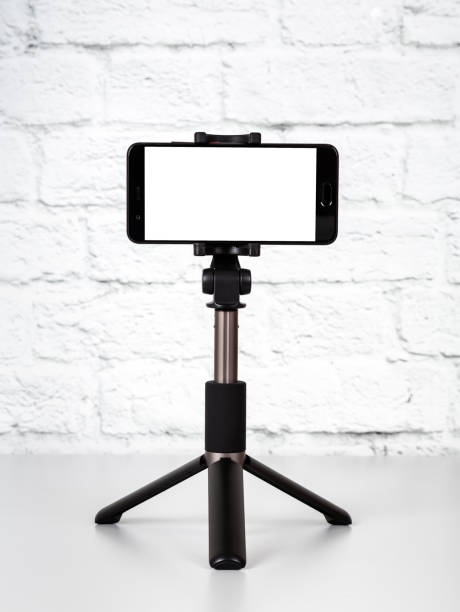 Mockup with smartphone on a tripod with empty screen stock photo